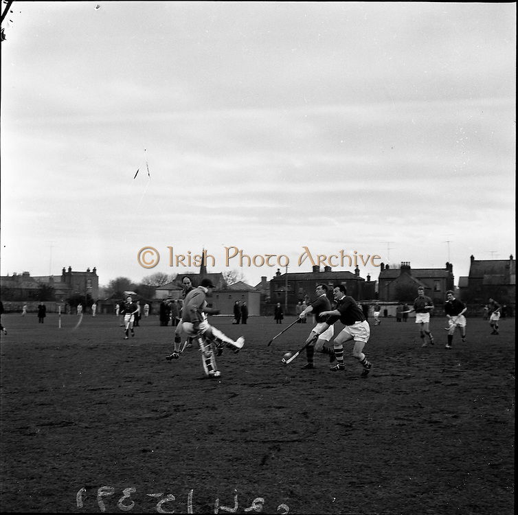 20/01/1962.01/20/1962.20 January 1962.Leinster v Munster Interprovincial Mens Hockey, played at Londonbridge Road, Dublin..Leinster goalie, Griffiths, kicks clear in the face of an attack of L. Byrne (Munster) and his teammate.