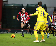 Brentford midfielder Alan McCormack looking for a forward pass during the Sky Bet Championship match between Brentford and Nottingham Forest at Griffin Park, London, England on 21 November 2015. Photo by Matthew Redman.