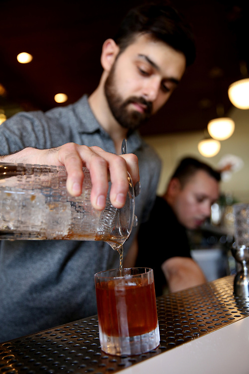 Emilio Salehi makes the Hound Dog drink at The Beehive, Saturday, May 5, 2018, in San Francisco, Calif. The Beehive is located at 842 Valencia Street.