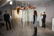 """Performance Artist Millie Brown Millie Brown performs """"Rainbow Body""""- a site specific performance installation, where she suspends her body surrounded by crystal prisms, from the ceiling of the gallery on Dover Street for the duration of Frieze one of the busiest weeks in the captial's art scene. Contemporary art gallery Gazelli Art House supports and presents a wide range of international artists."""