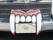Fangs rest on the front of a hearse during the 6th Annual Doylestown at Dusk Car Show Saturday July 18, 2015 in Doylestown, Pennsylvania. (Photo by William Thomas Cain)