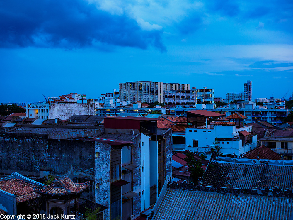 21 AUGUIST 2018 - GEORGE TOWN, PENANG, MALAYSIA:  The George Town, Penang, skyline at evening as clouds and thunderstorms roll in.     PHOTO BY JACK KURTZ