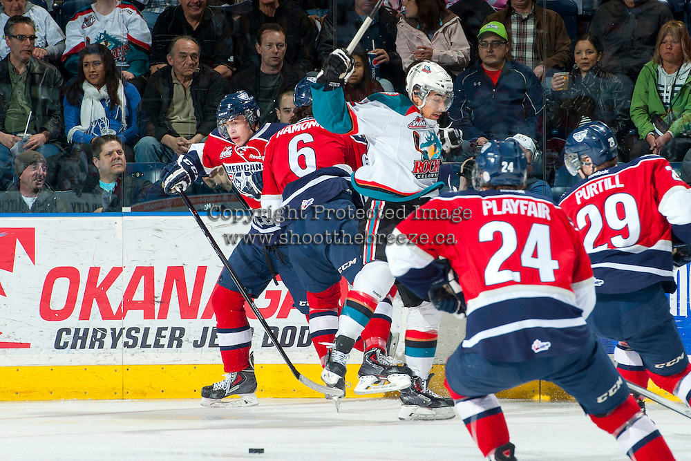 KELOWNA, CANADA - MARCH 22: Tyrell Goulbourne #12 of the Kelowna Rockets is checked by Justin Hamonic #6 of the Tri-City Americans on March 22, 2014 at Prospera Place in Kelowna, British Columbia, Canada.   (Photo by Marissa Baecker/Shoot the Breeze)  *** Local Caption *** Tyrell Goulbourne; Justin Hamonic;
