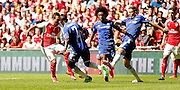 Nemanja Matic ending Santi Carzola's run during the FA Community Shield match between Chelsea and Arsenal at Wembley Stadium, London, England on 2 August 2015. Photo by Michael Hulf.