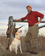 Pheasant Hunting Keith Crowley and his Yellow Lab, Rosie, pheasant hunting in North Dakota.