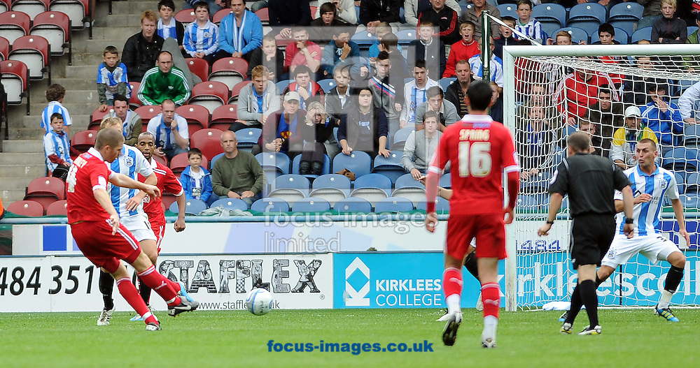 Picture by Graham Crowther/Focus Images Ltd. 07763140036.24/9/11 .Ben Chorley of Leyton Orient scores the equaliser against Huddersfield during the Npower League 1 game at the Galpharm Stadium, Huddersfield.