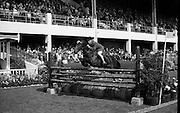 "08/08/1967<br /> 08/08/1967<br /> 08 August 1967<br /> R.D.S. Horse Show, Ballsbridge, Dublin. Photo shows Kenneth Scott, Lisdoonan, Saintfield, Co. Down, winner of competition A (Children) jumping. Horse is possibly ""Golden Vale""."