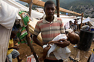 Families displaced from their homes in the Carrefour area of Port Au Prince, Haiti on Saturday  January 17, 2010.