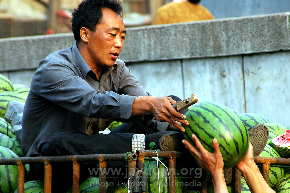 China, Taiyuan, 2007. Summertime welcomes thousands of watermelons into Chinese homes. Farmers devote a lot of their precious irrigation resources to this popular fruit..