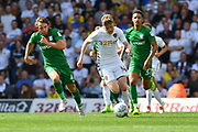 Leeds United midfileder Eunan O'Kane (14) and Preston North End midfielder Ben Pearson (4)  during the EFL Sky Bet Championship match between Leeds United and Preston North End at Elland Road, Leeds, England on 12 August 2017. Photo by Ian Lyall.