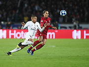 Virgil van Dijk of Liverpool against Kylian Mbappé of Paris Saint-Germain during the Champions League group stage match between Paris Saint-Germain and Liverpool at Parc des Princes, Paris, France on 28 November 2018.