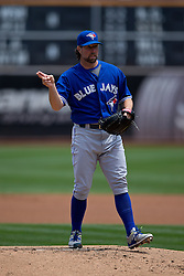 OAKLAND, CA - JULY 23:  R.A. Dickey #43 of the Toronto Blue Jays stands on the pitchers mound during the first inning against the Oakland Athletics at O.co Coliseum on July 23, 2015 in Oakland, California. The Toronto Blue Jays defeated the Oakland Athletics 5-2. (Photo by Jason O. Watson/Getty Images) *** Local Caption *** R.A. Dickey