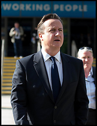 The Prime Minister David Cameron walking around  The Conservative Party Conference in Manchester, United Kingdom. Sunday, 29th September 2013. Picture by Andrew Parsons / i-Images