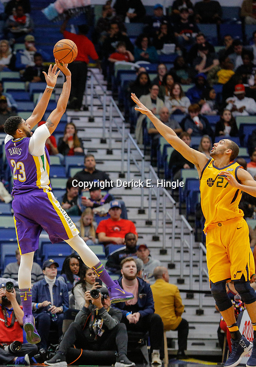 Feb 5, 2018; New Orleans, LA, USA; New Orleans Pelicans forward Anthony Davis (23) shoots over Utah Jazz center Rudy Gobert (27) during the second half at the Smoothie King Center. The Jazz defeated the Pelicans 133-109. Mandatory Credit: Derick E. Hingle-USA TODAY Sports