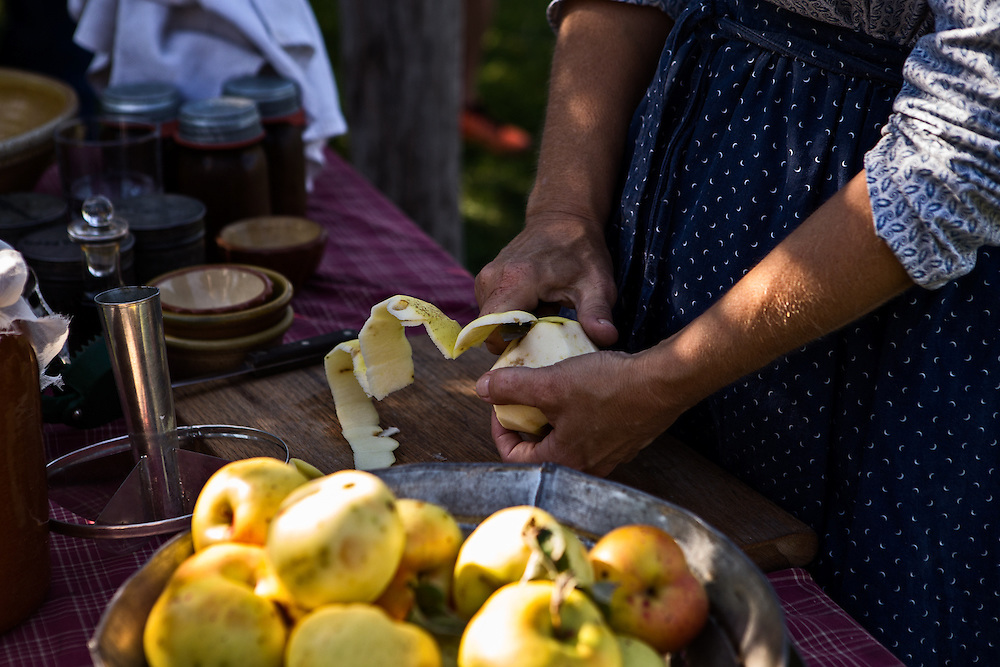 Peeling apples during a demonstration at Greenfield Village's Fall Flavors program.  Photographed by KMS Photography