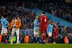 MANCHESTER, ENGLAND - Thursday, January 3, 2019: Liverpool's Virgil van Dijk and Manchester City's Bernardo Silva during the FA Premier League match between Manchester City FC and Liverpool FC at the Etihad Stadium. (Pic by David Rawcliffe/Propaganda)