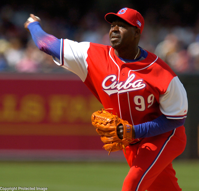 Team Cuba's Pedro Lazo throws a pitch in he 5th inning against Team Dominican Republic in the 5th inning in Semi-Final action of the World Baseball Classic at PETCO Park, San Diego, CA.