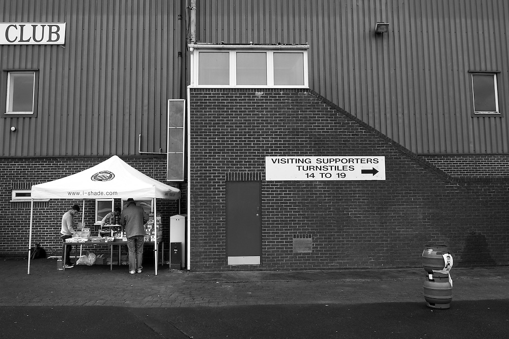 FC United of Manchester play a local team Chorley at Bury football club's ground in Lancashire, Britain. Photo shows club memorabilia being sold before the game.