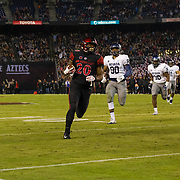 18 November 2017:  The San Diego State football team hosts Nevada Saturday night. San Diego State Aztecs running back Rashaad Penny (20) rushes the ball for a touchdown in the first quarter. The Aztecs lead 21-14 at the half. <br /> www.sdsuaztecphotos.com