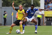 Ipswich Town defender Janoi Donacien and Burton Albion forward Liam Boyce challenge for the ball during the EFL Sky Bet League 1 match between Burton Albion and Ipswich Town at the Pirelli Stadium, Burton upon Trent, England on 3 August 2019.