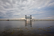 The Inner Harbor Navigation Canal Lake Borgne Surge Barrier also called The Great Wall of Louisiana, is a nearly two-mile-long, 26-foot-high barrier built for hurricane protection to prevent the kind of flooding that ravaged New Orleans by Katrina. The wall crosses Gulf Intracoastal Waterway and Bayou Bienvenue and has three gates boats can use for passage unless a storm threatens. The project was created by the US Army Corps of Engineers.