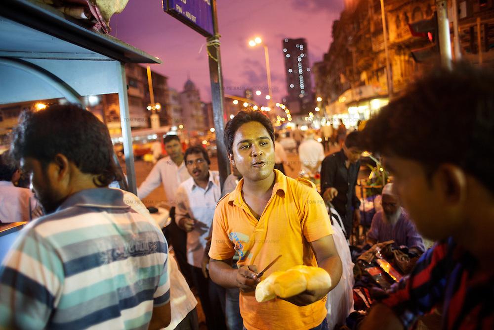 Street scene in Mumbai as the monsoon breaks.<br /> <br /> Photo: Tom Pietrasik<br /> June 4th 2013