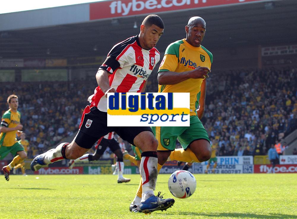 Photo: Ashley Pickering.<br /> Norwich City v Southampton. Coca Cola Championship. 28/04/2007.<br /> Southampton goal scorer Leon Best (L) tries to get around Dion Dublin of Norwich