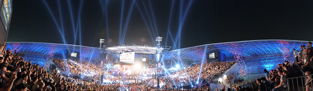 "ABU DHABI, UNITED ARAB EMIRATES, APRIL 10, 2010: In this multiple exposure panoramic image, the crowd awaits the start of the main card at ""UFC 112: Invincible"" inside Ferari World, Abu Dhabi on April 10, 2010"