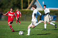 Essex's Kirk Teare (8) kicks the ball down the field during the boys soccer game between the Champlain Valley Union Redhawks and the Essex Hornets at Essex High School on Saturday mooring October 10, 2015 in Essex. (BRIAN JENKINS/For the FREE PRESS)
