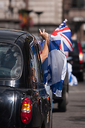 "Royal Courts of Justice, London,  August 31st 2014. Taxi drivers show their colours as as thousands of Jews and their supporters from London and across the UK demand ""Zero Tolerance for Antisemites"", organised by the Campaign Against Antisemitism."