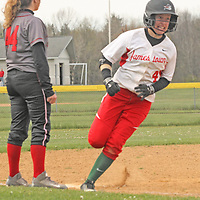 Jamestown's Lauren Madden rounds third base en-route to scoring a homerun during baseball action against Maple Grove 5-10-16 photo by Mark L. Anderson