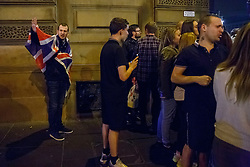 © Licensed to London News Pictures. 19/09/2014. Glasgow, UK. A man with union jack takes side with Scottish independence supporters who posing against pro-Unionists at George Square in Glasgow as Scotland decides to stay in the union and First Minister Alex Salmond resigns over the results of the Scottish independence referendum on Friday, 19 September 2014. Photo credit : Tolga Akmen/LNP