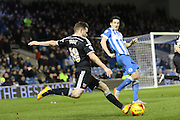 Brentford midfielder Alan Judge (18) crosses the ball during the Sky Bet Championship match between Brighton and Hove Albion and Brentford at the American Express Community Stadium, Brighton and Hove, England on 5 February 2016. Photo by Geoff Penn.
