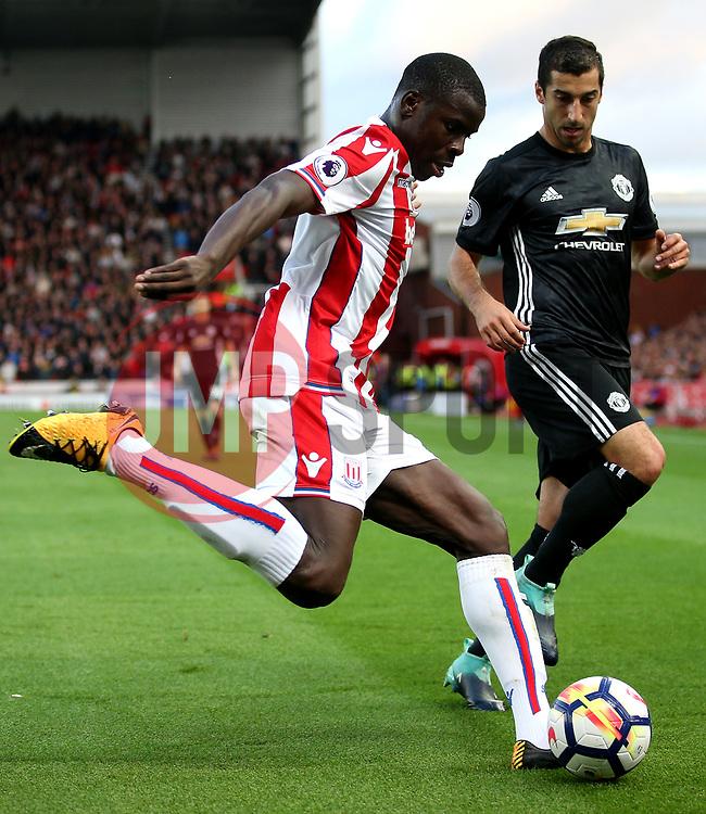 Kurt Zouma of Stoke City clears under pressure from Henrikh Mkhitaryan of Manchester United - Mandatory by-line: Matt McNulty/JMP - 09/09/2017 - FOOTBALL - Bet365 Stadium - Stoke-on-Trent, England - Stoke City v Manchester United - Premier League