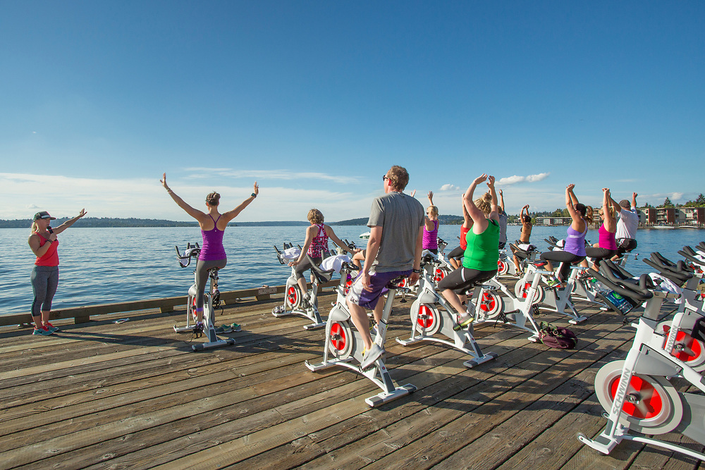 United States, Washington, Kirkland, exercise class on dock by Lake Washington