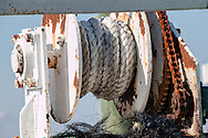 Tools of the Trade<br /> Closeup of spooled rope and winding gears and wonderful &quot;rustification&quot; of a fishing boat on Chincoteague Island, Maryland. Chincoteague is a combination fishing town, vacation homes, businesses and wildlife preserve.