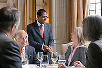 Business people at meeting at restaurant one man standing