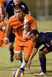 Virginia Cavaliers F Nino DiMaggio (19) grabs the ball from Mount Saint Mary's Mountaineers D Joshua Barnaby (16)...The #4 ranked Virginia Cavaliers men's soccer team defeated the Mount Saint Mary's Mountaineers 3-0 at Klockner Stadium in Charlottesville, VA on September 25, 2007.