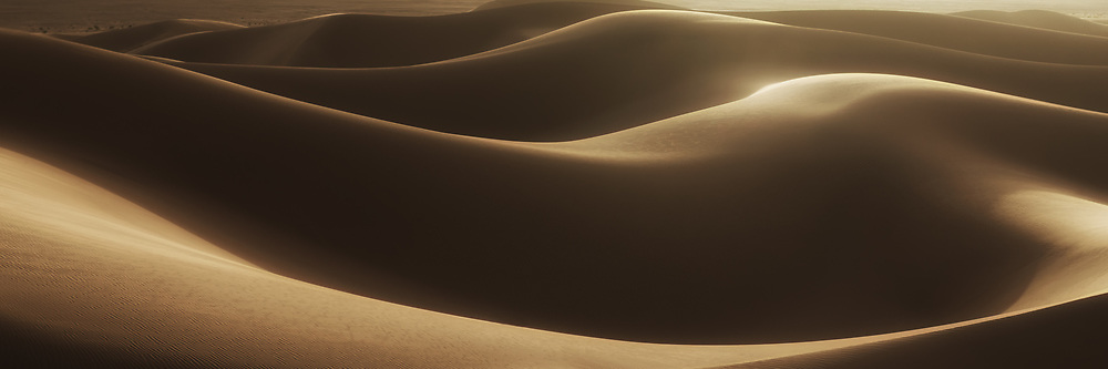 Abstract desert sand dunes with deep shadows, Morocco.