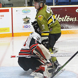 "TRENTON, ON  - MAY 4,  2017: Canadian Junior Hockey League, Central Canadian Jr. ""A"" Championship. The Dudley Hewitt Cup. Game 5 between Powassan Voodoos and the Georgetown Raiders.  Parker Bowman #17 of the Powassan Voodoos drives to the net and score a goal during the second period.<br /> (Photo by Tim Bates / OJHL Images)"