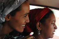 Niger,Agadez,2007. Fatima and Halimata Ixa on the way home. They are lucky to have a car, as there is little public transportation infrastructure in Agadez.