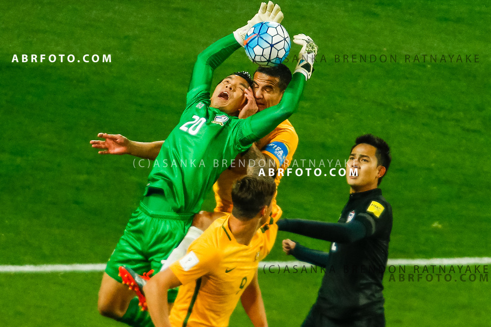 MELBOURNE, AUSTRALIA - SEPTEMBER 5 : Sinthaweechai Hathairattanakool of Thailand attempts to catch the ball as Tim Cahill of the Australia Socceroos leaps during the Stage 3 Group World Cup Football Qualifiers between Australia Vs Thailand at the Melbourne Rectangular Stadium, Melbourne, Australia 5 September 2017.