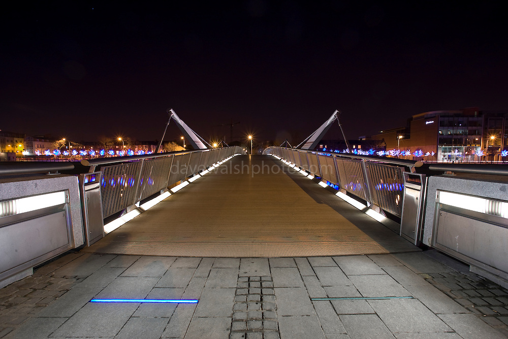 Sean O'Casey Bridge Dublin at night.....This pedestrian bridge, which links Custom House Quay with City Quay, is named after the Dublin writer Sean O'Casey. Architect: Cyril O'Neill