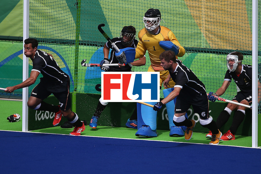 RIO DE JANEIRO, BRAZIL - AUGUST 11:  Martin Haner #6, Tobias Hauke #13, Mathias Muller #2 and Nicolas Jacobi #1 of Germany defend against Argentina during a Men's Preliminary Pool B match on Day 6 of the Rio 2016 Olympics at the Olympic Hockey Centre on August 11, 2016 in Rio de Janeiro, Brazil.  (Photo by Sean M. Haffey/Getty Images)