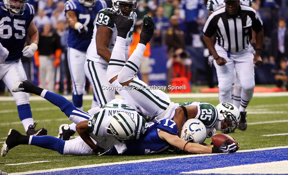 Indianapolis Colts wide receiver Austin Collie (17) reaches for the goal line after catching a pass during the AFC Championship football game against the New York Jets, January 24, 2010 in Indianapolis, Indiana. The Colts won the game 30-17. ©Paul Anthony Spinelli