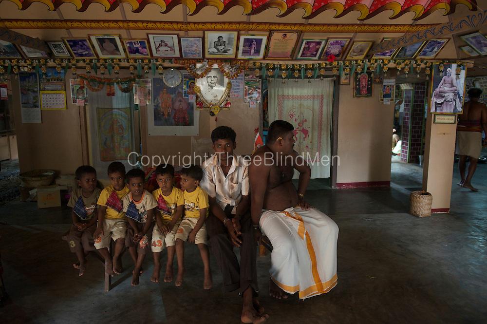 Children on a trip to Jaffna from Vavuniya, await their turn for lunch at Mohan's Ashram, Thondamanaru.