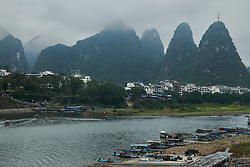 Boats moored at the riverside at GREE Tour of Guangxi Women's World Tour 2018, a 145.8 km road race in Guilin, China on October 21, 2018. Photo by Sean Robinson/velofocus.com