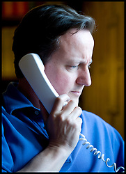 British Prime Minister David Cameron talks to President Obama on the phone in his office at Chequers about the BP situation in the Gulf of Mexico, Saturday June 12, 2010. Photo By Andrew Parsons / i-Images.