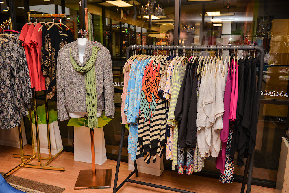 Racks of clothing items for sale at NOTO Boutique.
