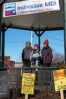 Bar Harbor, Maine, USA. 19 January, 2019. Ella Izenour, Caroline Musson, and Charlotte Partin address the crowd gathered on the Village Green for the Women's March Bar Harbor, a sister march of the national Women's March.